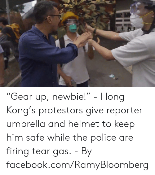 "Dank, Facebook, and Police: ""Gear up, newbie!"" - Hong Kong's protestors give reporter umbrella and helmet to keep him safe while the police are firing tear gas. - By facebook.com/RamyBloomberg"