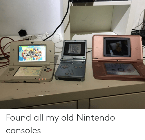 Nintendo, Smashing, and Camera: 01101 0001  GAMEBOY 81  18:28  NCRED  0RRRN ACT  Nac  OP  or  SUPER  SMASH BR  瘳  4 Camera  GAME BOY ADVANCE Found all my old Nintendo consoles