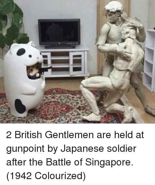 Singapore: 2 British Gentlemen are held at gunpoint by Japanese soldier after the Battle of Singapore. (1942 Colourized)