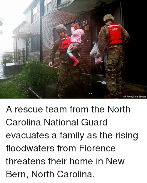 Bern: 83  SERT  AP Photo/Chris Seward A rescue team from the North Carolina National Guard evacuates a family as the rising floodwaters from Florence threatens their home in New Bern, North Carolina.