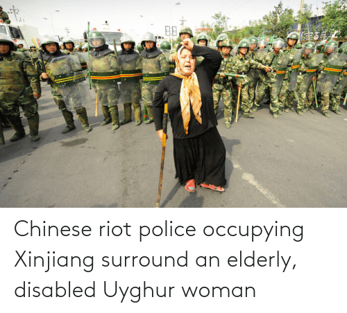 Police, Riot, and Chinese: 88 Chinese riot police occupying Xinjiang surround an elderly, disabled Uyghur woman