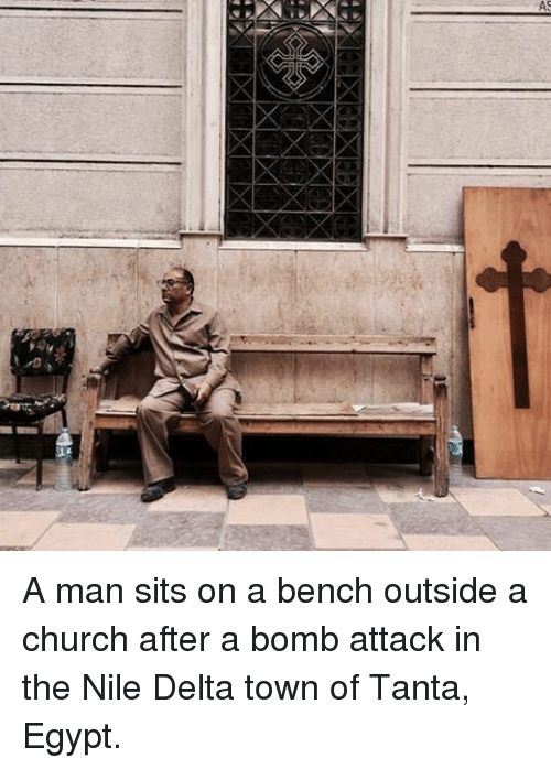 À   À  : A A man sits on a bench outside a church after a bomb attack in the Nile Delta town of Tanta, Egypt.
