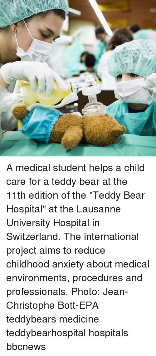 """christophe: A medical student helps a child care for a teddy bear at the 11th edition of the """"Teddy Bear Hospital"""" at the Lausanne University Hospital in Switzerland. The international project aims to reduce childhood anxiety about medical environments, procedures and professionals. Photo: Jean-Christophe Bott-EPA teddybears medicine teddybearhospital hospitals bbcnews"""