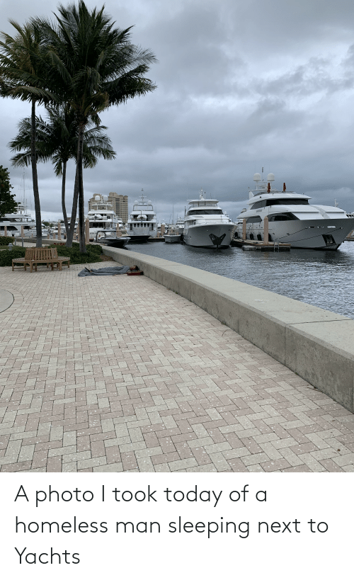homeless man: A photo I took today of a homeless man sleeping next to Yachts