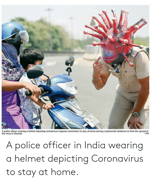 Wearing: A police officer in India wearing a helmet depicting Coronavirus to stay at home.
