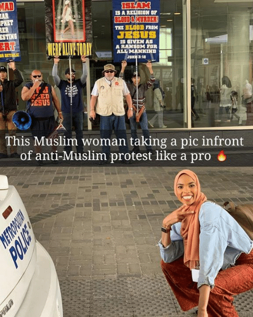 Jesus, Memes, and Muslim: AD  AR  PHET  SLAM  IS A REIIGION OF  BLOD&MURDER  THE BLO0D FROM  JESUS  STING  ER  S GIVEN AS  A RANSOM FOR  ALL MANKIND  JONK 3:10  ESUS  This Muslim woman taking a pic infront  of anti-Muslim protest like a pro