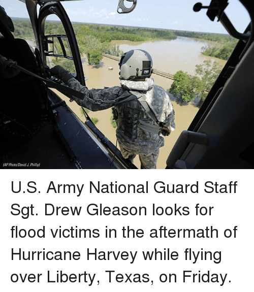 Drewing: AP Photo David J Phillip) U.S. Army National Guard Staff Sgt. Drew Gleason looks for flood victims in the aftermath of Hurricane Harvey while flying over Liberty, Texas, on Friday.