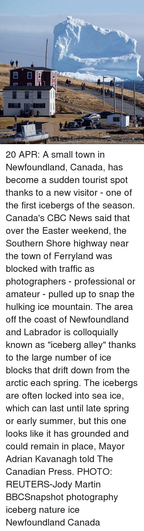 """newfoundland: E  LII 20 APR: A small town in Newfoundland, Canada, has become a sudden tourist spot thanks to a new visitor - one of the first icebergs of the season. Canada's CBC News said that over the Easter weekend, the Southern Shore highway near the town of Ferryland was blocked with traffic as photographers - professional or amateur - pulled up to snap the hulking ice mountain. The area off the coast of Newfoundland and Labrador is colloquially known as """"iceberg alley"""" thanks to the large number of ice blocks that drift down from the arctic each spring. The icebergs are often locked into sea ice, which can last until late spring or early summer, but this one looks like it has grounded and could remain in place, Mayor Adrian Kavanagh told The Canadian Press. PHOTO: REUTERS-Jody Martin BBCSnapshot photography iceberg nature ice Newfoundland Canada"""