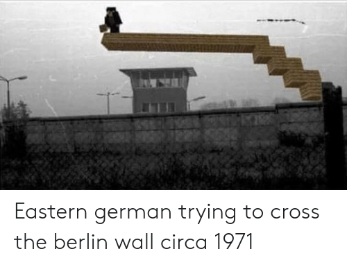 Cross, Berlin, and Berlin Wall: Eastern german trying to cross the berlin wall circa 1971