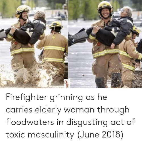 Grinning: Firefighter grinning as he carries elderly woman through floodwaters in disgusting act of toxic masculinity (June 2018)