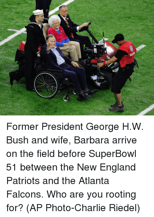 Atlanta Falcon: Former President George H.W. Bush and wife, Barbara arrive on the field before SuperBowl 51 between the New England Patriots and the Atlanta Falcons. Who are you rooting for? (AP Photo-Charlie Riedel)