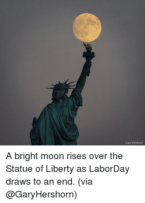 Mooned: Gary Hershorn A bright moon rises over the Statue of Liberty as LaborDay draws to an end. (via @GaryHershorn)