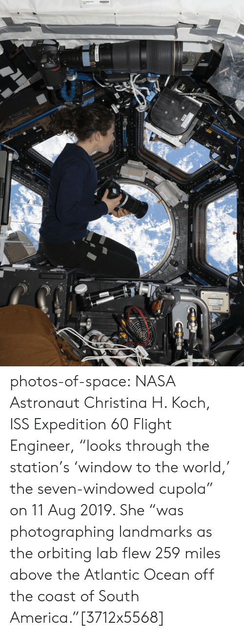 """America, Nasa, and Tumblr: le photos-of-space:  NASA Astronaut Christina H. Koch, ISS Expedition 60 Flight Engineer, """"looks through the station's 'window to the world,' the seven-windowed cupola"""" on 11 Aug 2019. She """"was photographing landmarks as the orbiting lab flew 259 miles above the Atlantic Ocean off the coast of South America.""""[3712x5568]"""