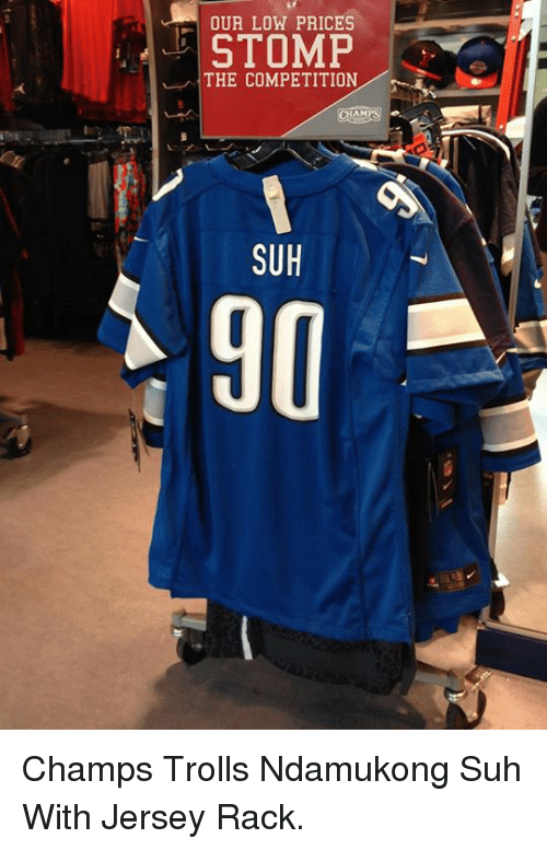 Nfl, Ndamukong Suh, and Suh: OUR LOW PRICES  STOMP  THE COMPETITION  SUH Champs Trolls Ndamukong Suh With Jersey Rack.
