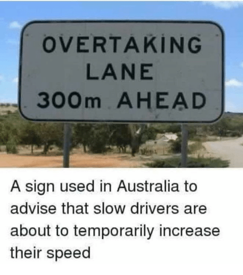 advise: OVERTAKİNG  LANE  300m AHEAD  A sign used in Australia to  advise that slow drivers are  about to temporarily increase  their speed