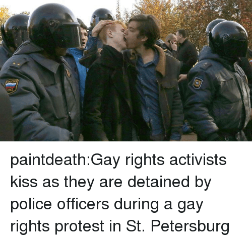 Police, Protest, and Tumblr: paintdeath:Gay rights activists kiss as they are detained by police officers during a gay rights protest in St. Petersburg