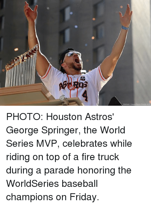 Astros: PHOTO: Houston Astros' George Springer, the World Series MVP, celebrates while riding on top of a fire truck during a parade honoring the WorldSeries baseball champions on Friday.