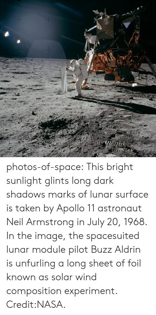 foil: photos-of-space:  This bright sunlight glints  long dark shadows marks of lunar surface is taken by Apollo 11 astronaut Neil Armstrong in July 20, 1968. In the image, the spacesuited lunar module pilot Buzz Aldrin is unfurling a long sheet of foil known as solar wind composition experiment. Credit:NASA.