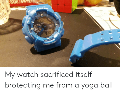 Watch, Yoga, and Sec: SHOCK  1/1000 SEC  1000  21  WE  S-SHOCK  WR3OM  938  MODE  SHOCK RESIST  BROTECTION  REVERSE  START STOPL  LLE  ADJUST My watch sacrificed itself brotecting me from a yoga ball