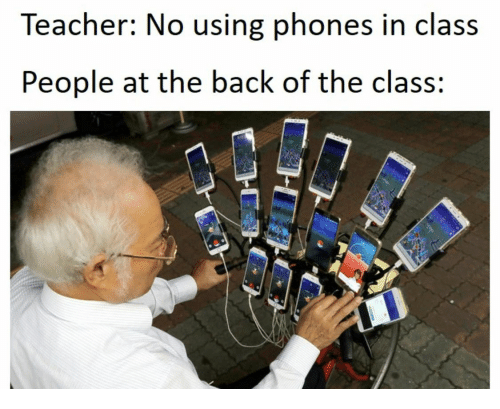 Teacher, Back, and Class: Teacher: No using phones in class  People at the back of the class:
