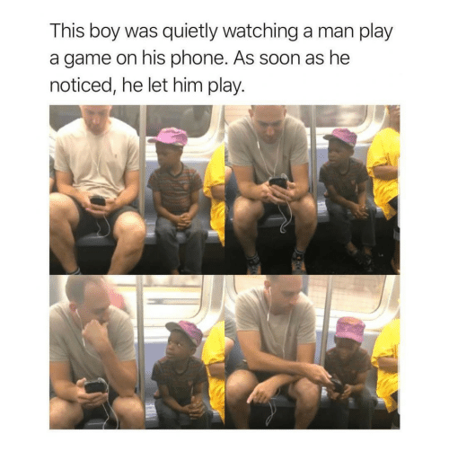 Phone, Soon..., and Game: This boy was quietly watching a man play  a game on his phone. As soon as he  noticed, he let him play.
