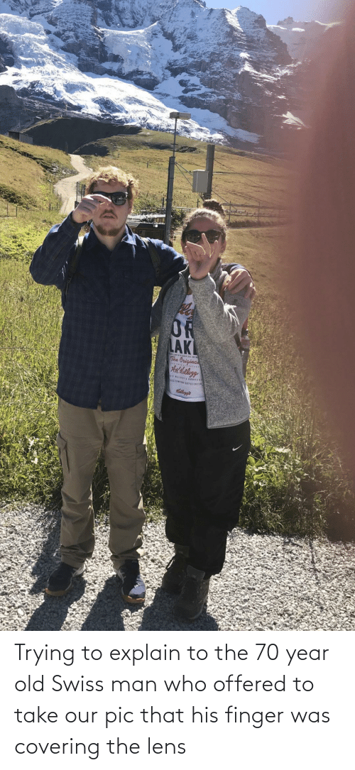pic: Trying to explain to the 70 year old Swiss man who offered to take our pic that his finger was covering the lens