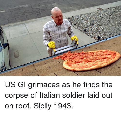 sicily: US GI grimaces as he finds the corpse of Italian soldier laid out on roof. Sicily 1943.