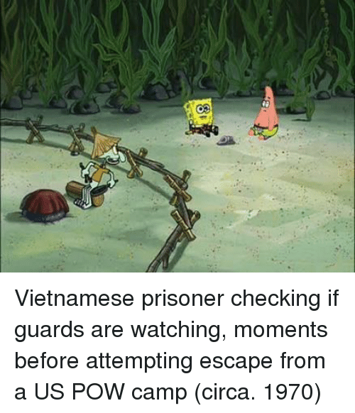 Vietnamese, Camp, and Circa: Vietnamese prisoner checking if guards are watching, moments before attempting escape from a US POW camp (circa. 1970)